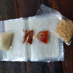 Bánh tráng và gia vị gồm: bơ, mắm me, muối tôm và chà bông.